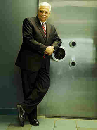 Banker Alden McDonald stands in front of the Liberty Bank safe.