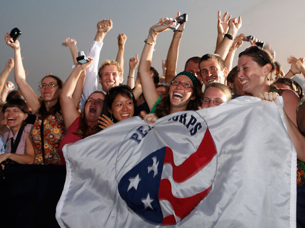 Peace Corps volunteers cheer as President Obama speaks at the airport in Accra, Ghana, in July 2009. Staying connected to friends and family back home is easier for volunteers these days, thanks to technology.
