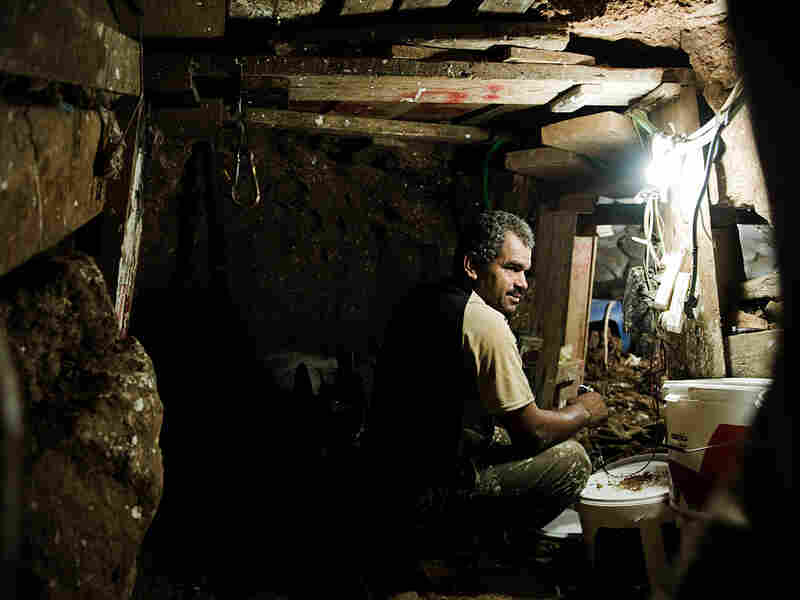 Gazans work in an underground smuggling tunnel between Gaza and Egypt