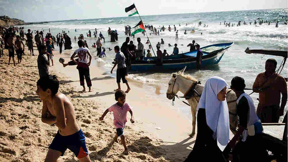 Palestinians enjoy the Mediterranean Sea at a Hamas-run beach club in Gaza City
