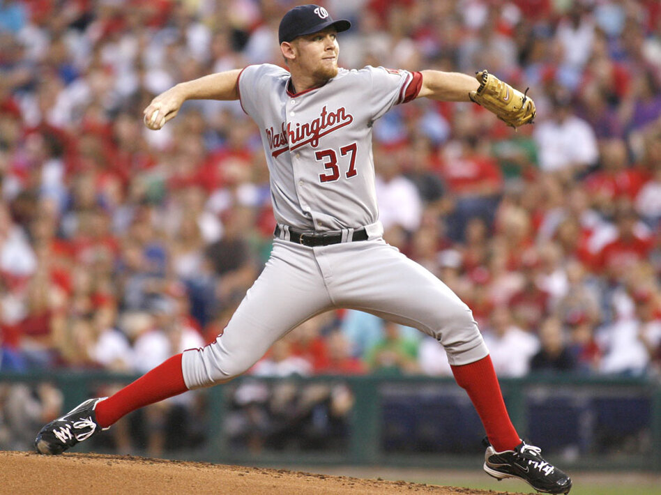 Washington Nationals' starting pitcher Stephen  Strasburg  throws against the Philadelphia Phillies in the first inning of a baseball game Aug. 21 in Philadelphia. Strasburg was removed from the game after complaining of arm pain, and the Nationals now say it is likely he will have to undergo ligament replacement surgery. (AP)
