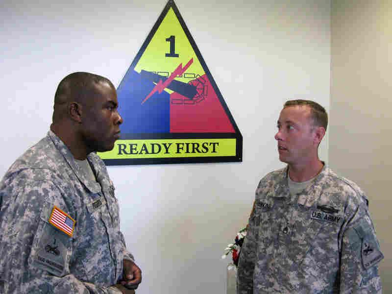Maj. Elliott Rogers (left) and Staff Sgt. Charles Hawkins talk in Fort Bliss in El Paso, Texas.