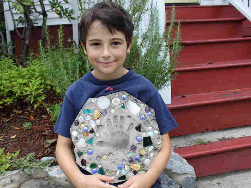 Sam Goldstein, 8, with the Father's Day present that was stolen from his family's steps.