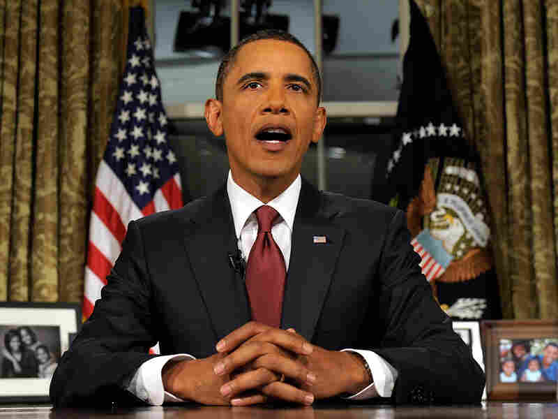 In this video image, President Obama speaks to the nation from the Oval Office.