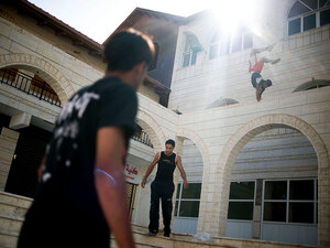 Young Palestinian men practice parkour