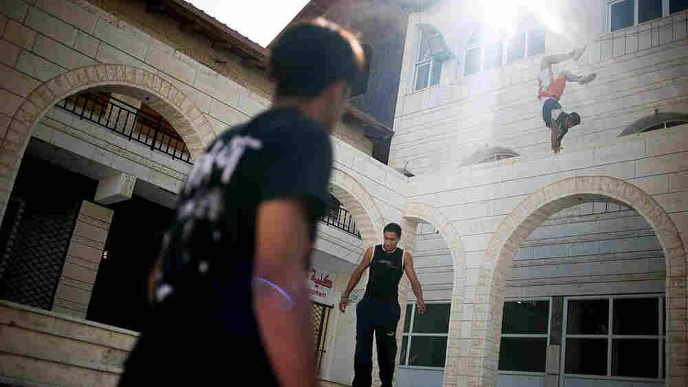 Young Palestinian men practice parkour