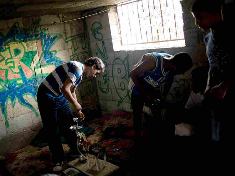 Palestinian teenagers hang out in a graffiti-covered warehouse.