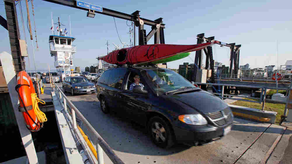 Cars leaving Ocracoke Island on a ferry arrive in Hatteras, N.C