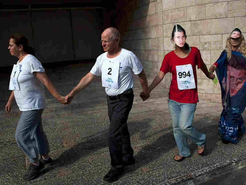 Aviva, left, and Noam Shalit, second left, protest their son's captivity
