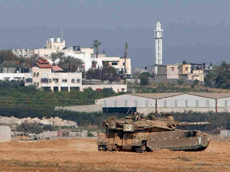 An Israeli tank monitors the border with the Gaza Strip near Kibbutz Nahal Oz