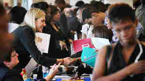 Job seekers speak with recruiters during a career fair  in Chicago.