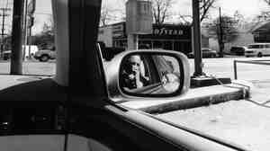 Lee Friedlander shoots America from behind the wheel