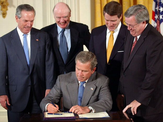 President Bush signs the 2003 tax cut package at the White House. With Bush are then-Commerce Secretary Donald Evans, Treasury Secretary John Snow, Senate Majority Leader Sen. Bill Frist, and House Ways and Means Chairman Rep. Bill Thomas.
