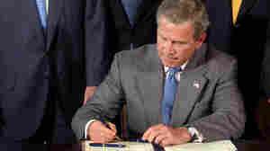 President Bush signs a package of tax cuts in 2003