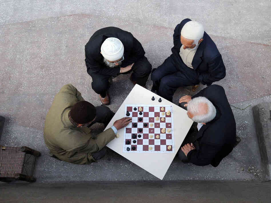 Kurdish men in Turkey play chess.