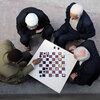 Kurdish men in Turkey play chess.