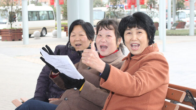 Residents of Jiangyin sing in one of the city's public squares