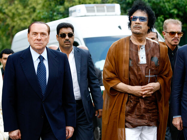 Libyan leader Moammar Gadhafi (right) and Italian Prime Minister Silvio Berlusconi in Rome on Aug. 30.  Gadhafi and Berlusconi marked a friendship treaty between their two countries amid increasing criticism over Gadhafi's exhortation to Italians to  convert to Islam and Libya's prominent role in the Italian economy.
