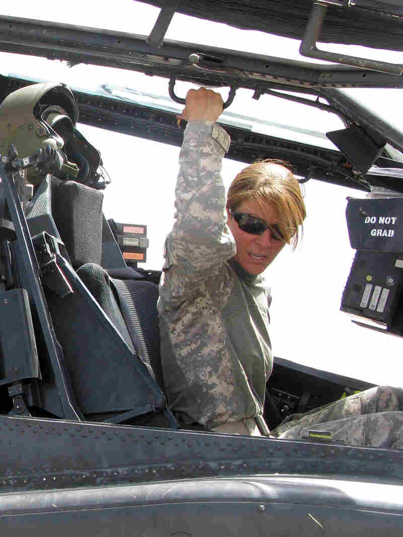 U.S. Army Capt. Nicole Jordan sits in the cockpit of an Apache attack helicopter