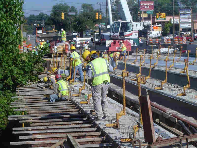 Workers replace a bridge in Nashville, Tenn., as part of a statewide project to rehab 200 bridges.