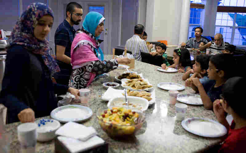 Kashif Munir and his family gather for dinner during an Eid celebration on Thursday.
