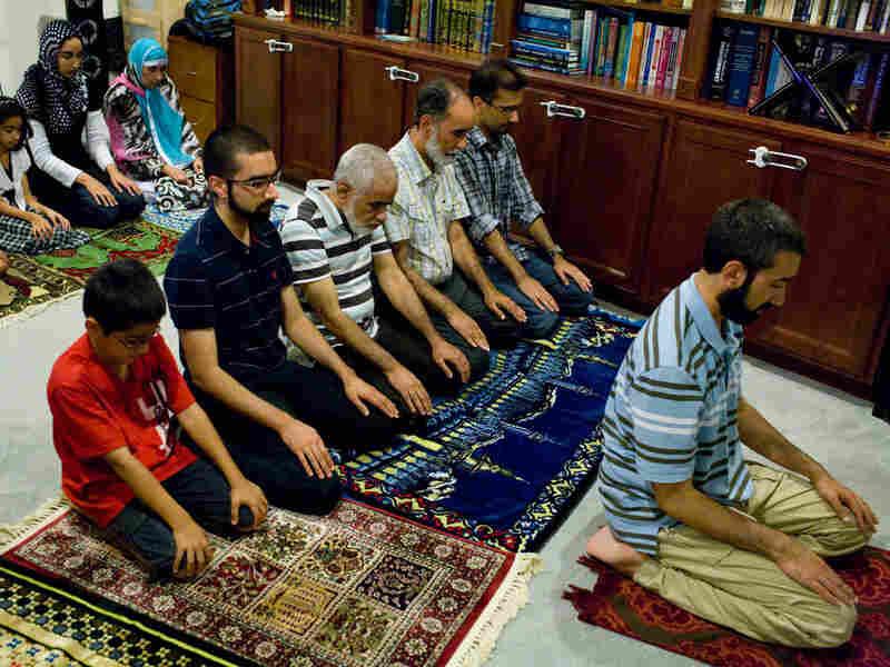 The Munir family prays after dinner.