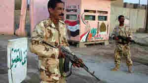 Sunni Awakening militiamen man a checkpoint in Samarra.