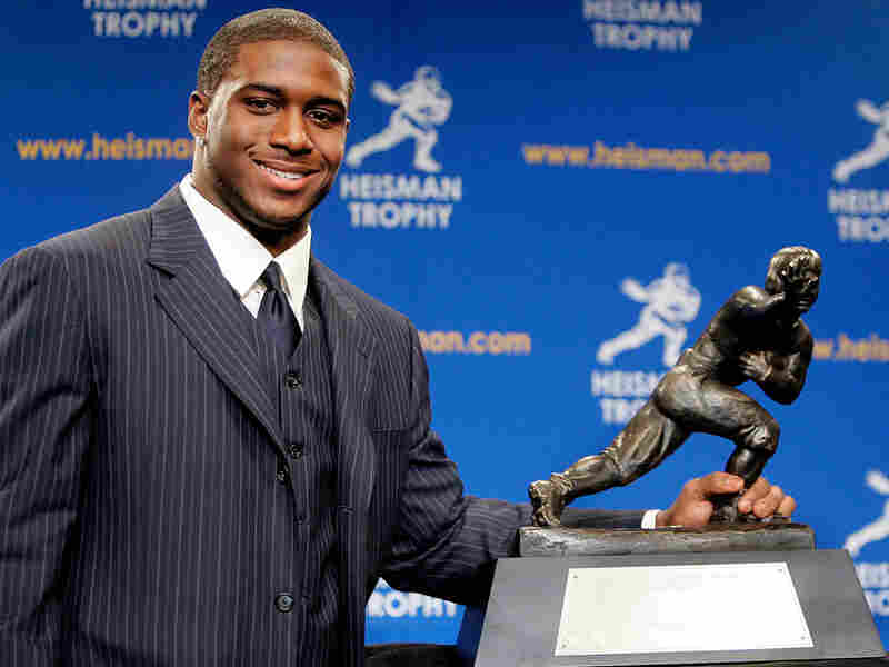 Reggie Bush poses with the Heisman Trophy in 2005.