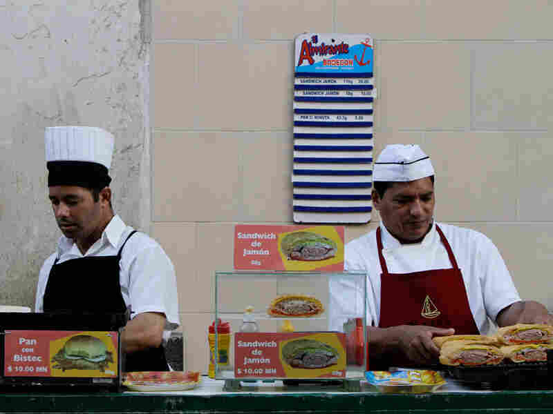 Workers prepare sandwiches at a snack bar in Havana.