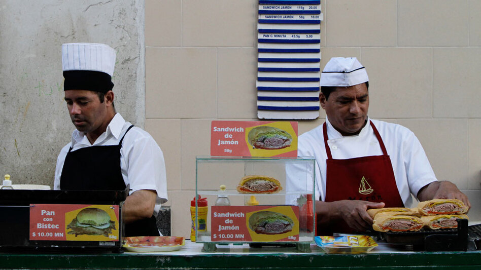 Workers  prepare sandwiches at a snack bar in Havana. Many Cubans are excited at the prospect of having more of a say in the workplace, but others are worried about higher crime and unanswered questions about the new economic landscape.