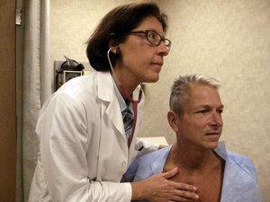 Internist Nesli Basgoz exams patient Barry Arcangeli who has a leaky heart valve.