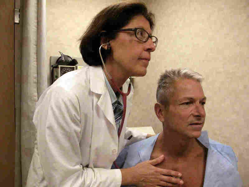 Internist Nesli Basgoz exams patient Barry Arcangeli who has a leaky heart valve.
