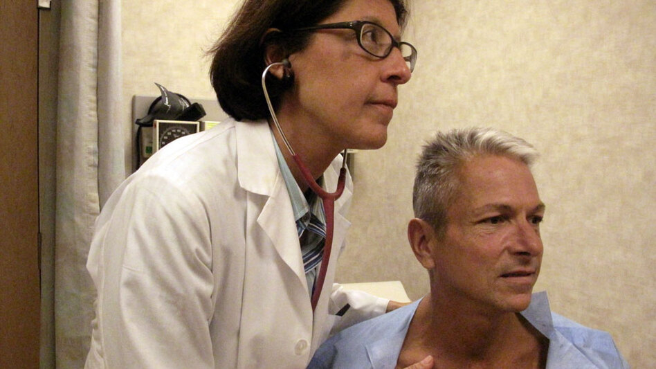 Internist Nesli Basgoz examines patient Barry Arcangeli who has a leaky heart valve. Basgoz discovered Arcangeli's heart condition during a routine physical examination.