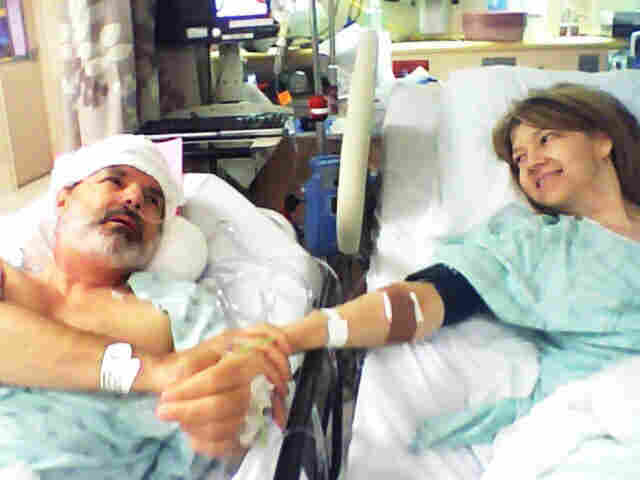 Jeff Moyer and Julie Stinson clasped hands after Moyer donated his kidney to her.