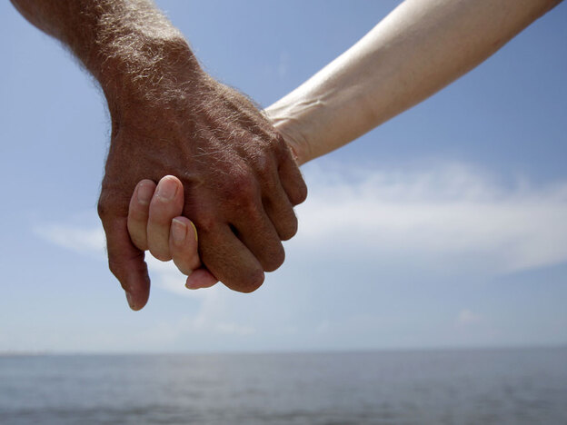 Hand-holding causes levels of the stress hormone cortisol to drop, says Matt Hertenstein, an experimental psychologist at DePauw University in Indiana. This couple joined hands while protesting offshore oil drilling in the wake of the Deepwater Horizon spill during a Hands Across the Sand event in Gulfport, Miss.