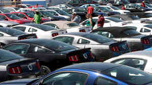 People shop for cars in Los Angeles in 2009.