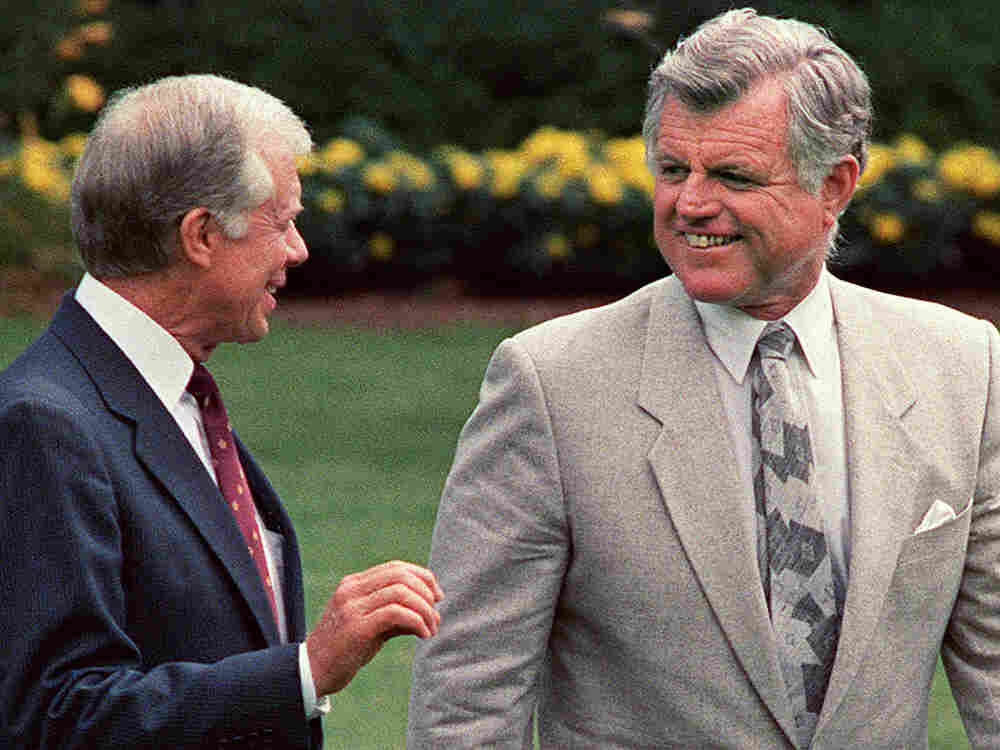 Former President Jimmy Carter, left, with his political rival Sen. Edward Kennedy in 1988.