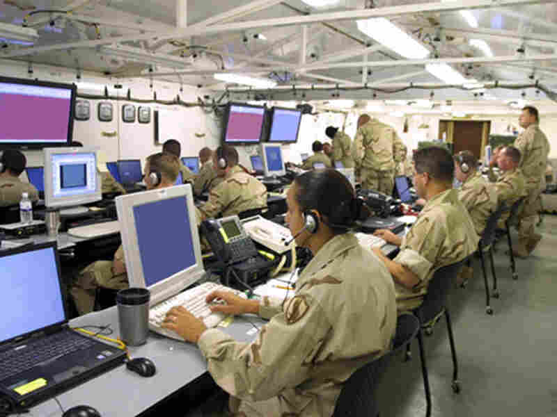 Soldiers monitor computer screens inside the U.S. Central Command's mobile headquarters.
