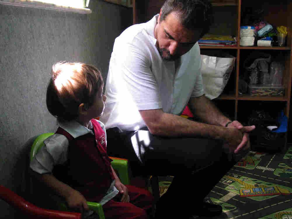 Mahmoud Jamal with a student at Jerusalem Kindergarten