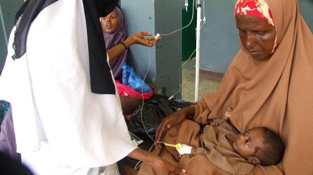 A doctor treats a child in Mogadishu, Somalia