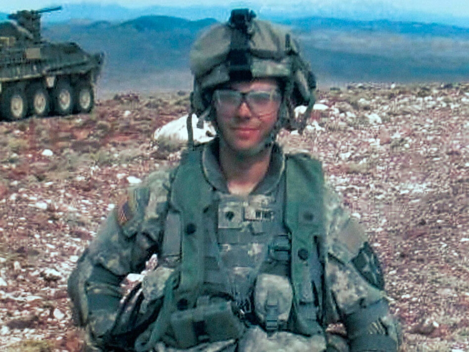 This undated photo released by the Winfield family shows U.S. Army Spc. Adam Winfield on duty in Afghanistan. Winfield is one of five American soldiers accused of murdering civilians in three separate incidents earlier this year.