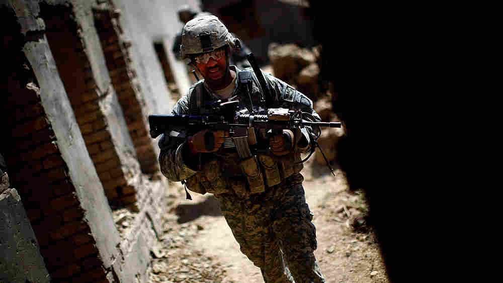 Sgt. 1st Class Phillip Carroll patrols outside Kandahar, Afghanistan