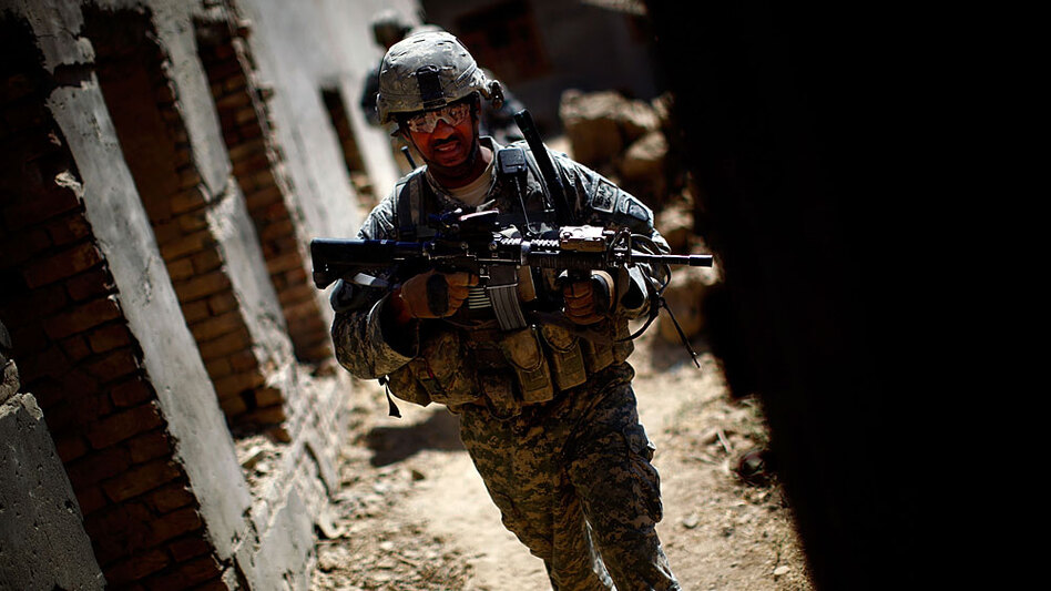Sgt. 1st Class Phillip Carroll, with the 101st Airborne Division, patrols in the Arghandab River valley outside Kandahar, Afghanistan, this week. Debate in Washington is growing over the scope and duration of continued U.S. military operations in Afghanistan.