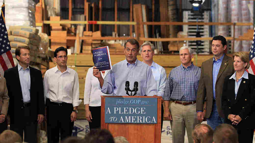 "House Minority Leader John Boehner of Ohio holds a copy of the ""Pledge To America"" plan."