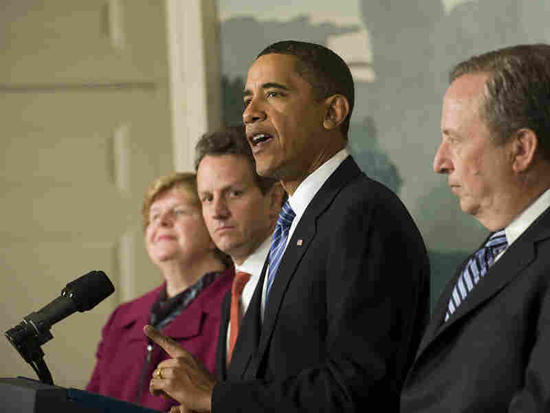 President Obama at the White House surrounded by some of his economic advisers.
