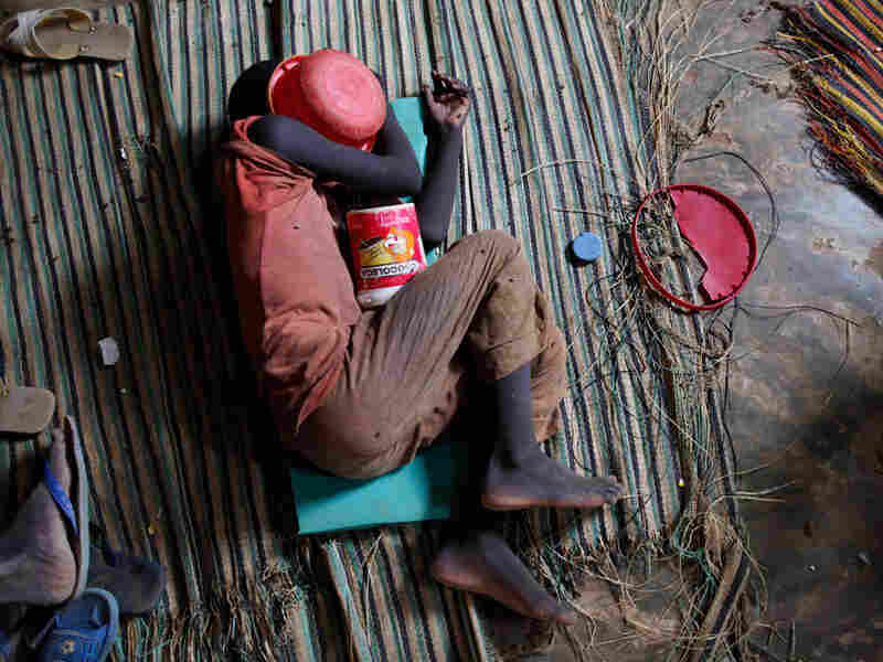 Quranic student sleeps with begging bowl over his head