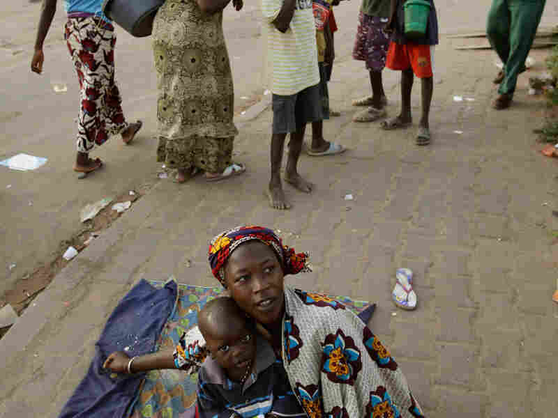 A Senegalese woman and her son beg in Dakar