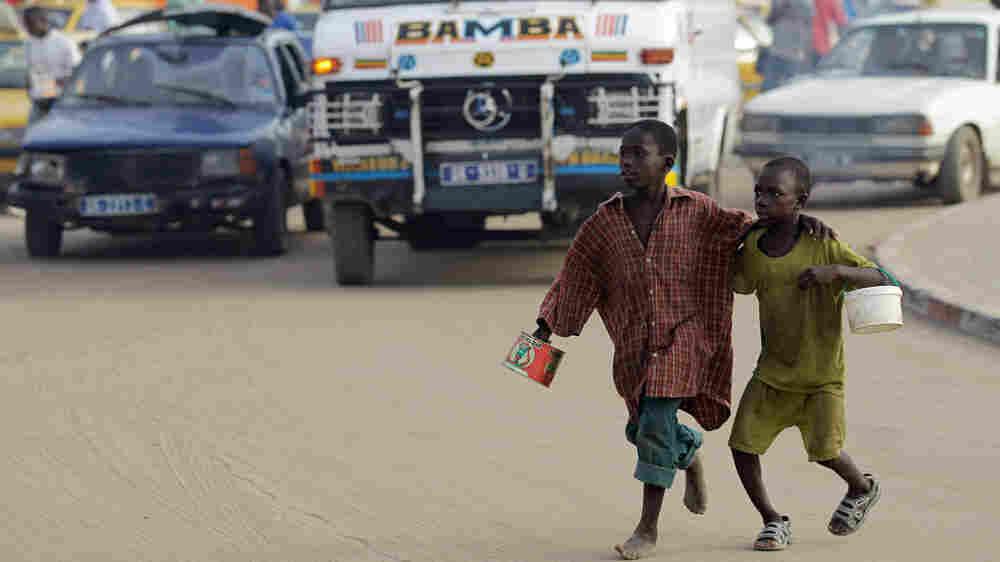 Quranic students begging on the streets of Dakar, Senegal
