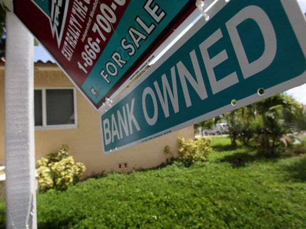 "A ""bank owned"" sign is posted in front  of a foreclosed home in Miami. Borrowers trying to rebuild their lives after foreclosure say there's a stigma attached to having a low credit score."