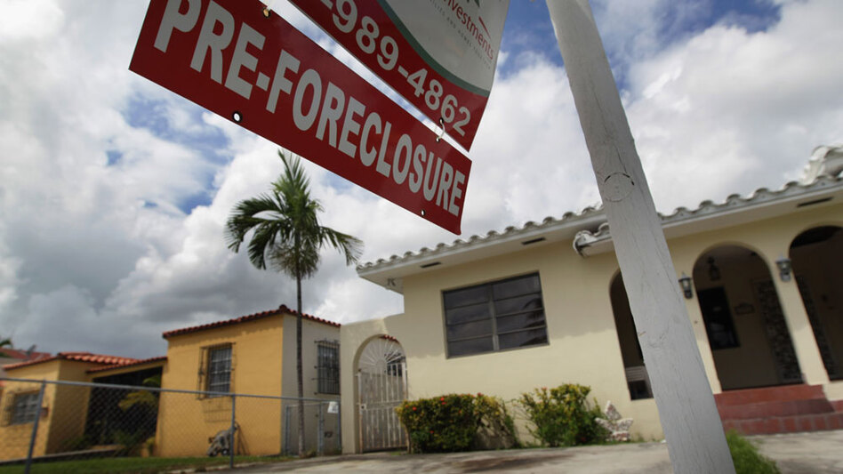 Some economists want the government to automatically refinance homeowners to prevent further foreclosures.